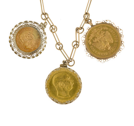 A nine karat gold necklace suspending seven gold coin and fourteen karat gold charms