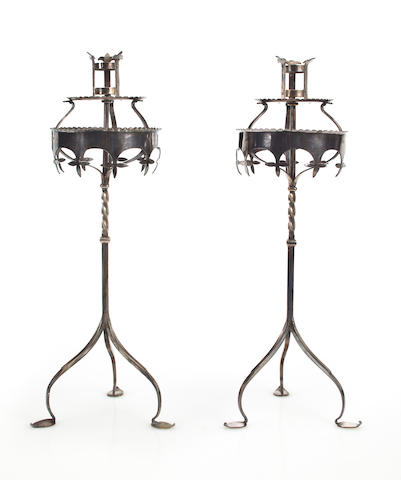 A pair of English Arts & Crafts silver-plated candlesticks circa 1890