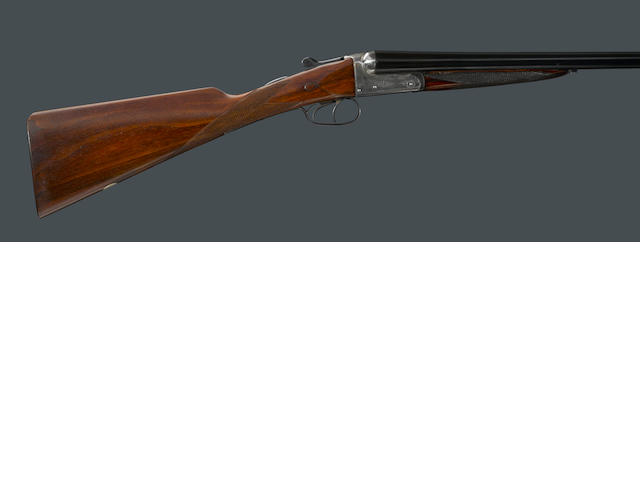 A 12 gauge English boxlock shotgun by E.J.Churchill