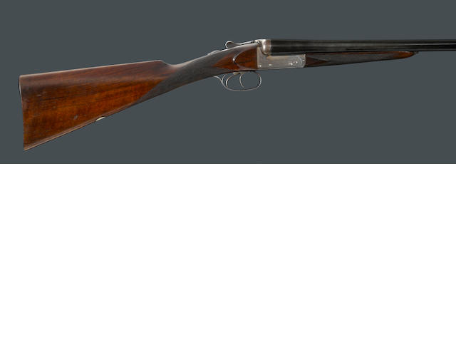A cased 12 gauge boxlock ejector shotgun by John Rigby & Company