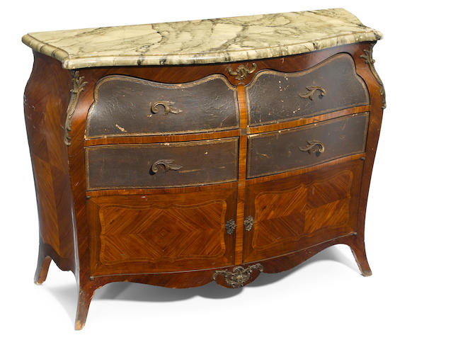 A Louis XV style gilt bronze mounted walnut commode
