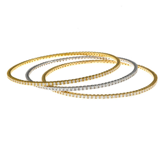 A collection of three eternity style diamond bangle bracelets