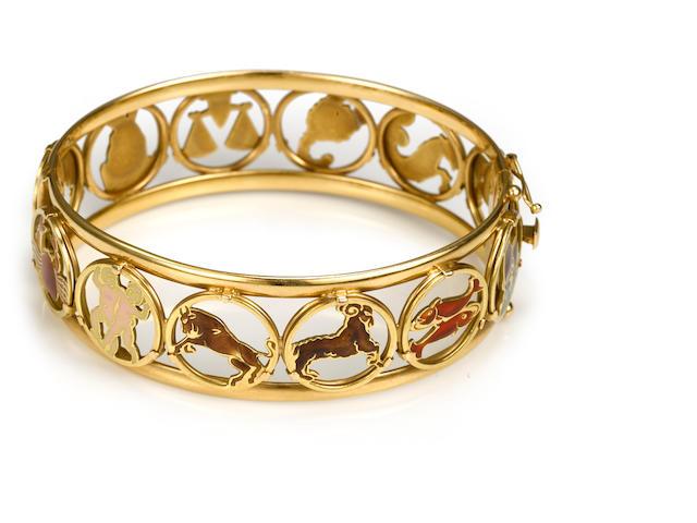 An enamel and 18k gold zodiac motif bangle bracelet