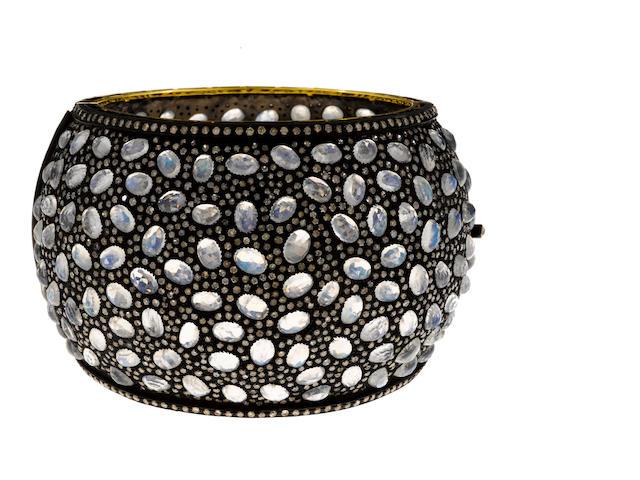 A moonstone and diamond wide bangle bracelet