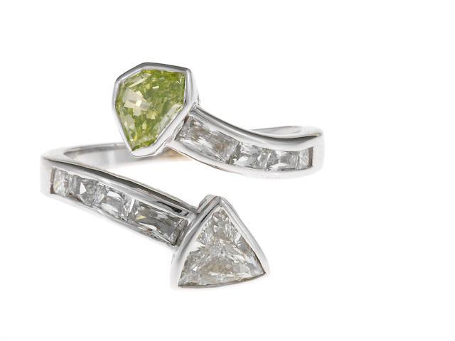 A fancy yellow diamond and diamond bypass ring