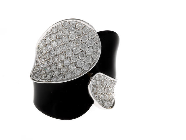 A diamond and black onyx double-crossover ring
