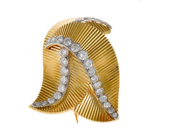 A retro diamond and eighteen karat gold foliate clip-brooch, Cartier, French,