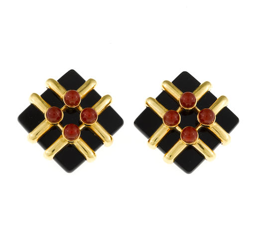 A pair of black onyx and carnelian earclips, Aldo Cipullo, Cartier,