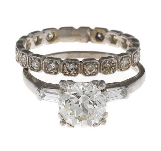 A diamond solitaire ring together with a diamond band