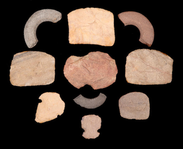 A Collection of Ten Bronze Age Bracelets, Hoes and Discs