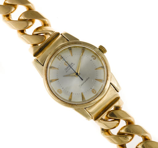 A fourteen karat gold wristwatch, Omega, with later eighteen karat gold bracelet strap