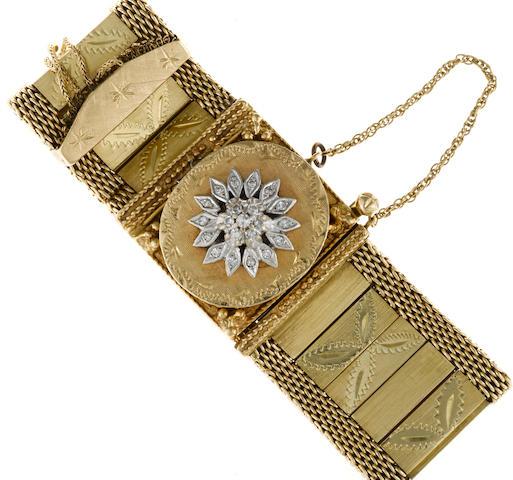 A diamond and fourteen karat gold covered dial bracelet wristwatch