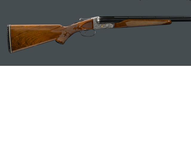 A 12 gauge Ithaca Grade 5E New Ithaca Double boxlock ejector shotgun
