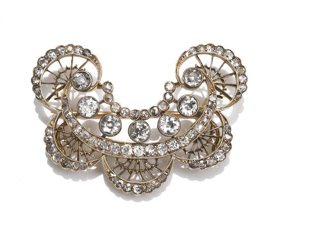 An antique diamond filigree brooch,
