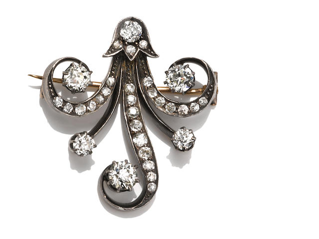 An antique diamond brooch,