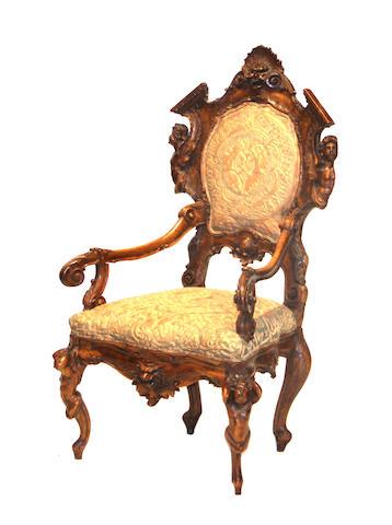 An Italian Rococo style walnut armchair mid 19th century