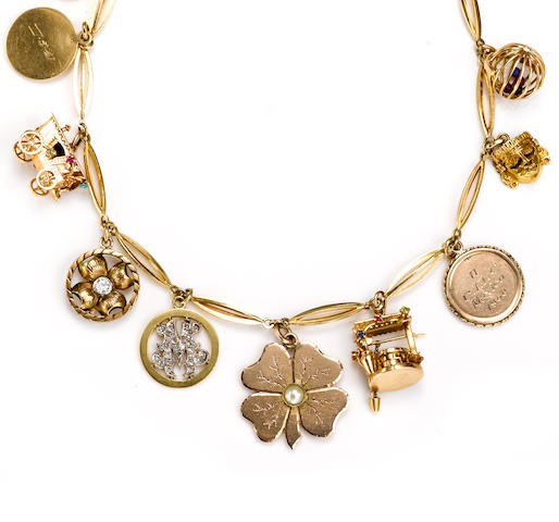 An eighteen karat gold charm necklace