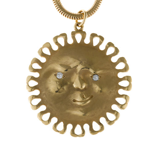 "A diamond and fourteen karat gold ""sun/moon"" pendant with chain"