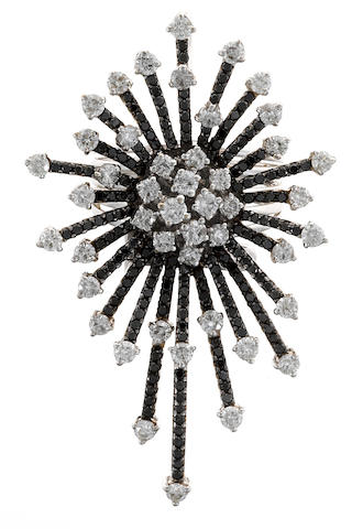 A black diamond and diamond starburst ring/pendant