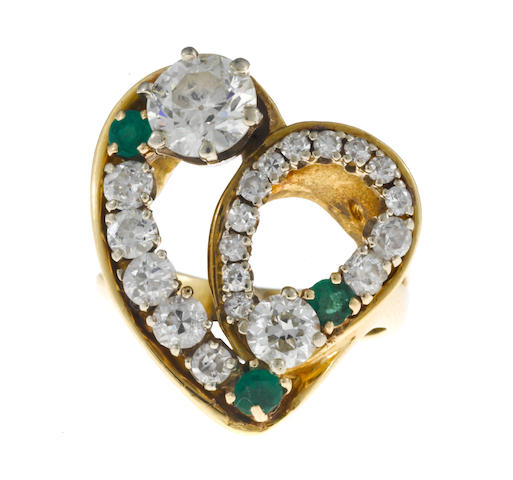 A diamond and emerald heart ring