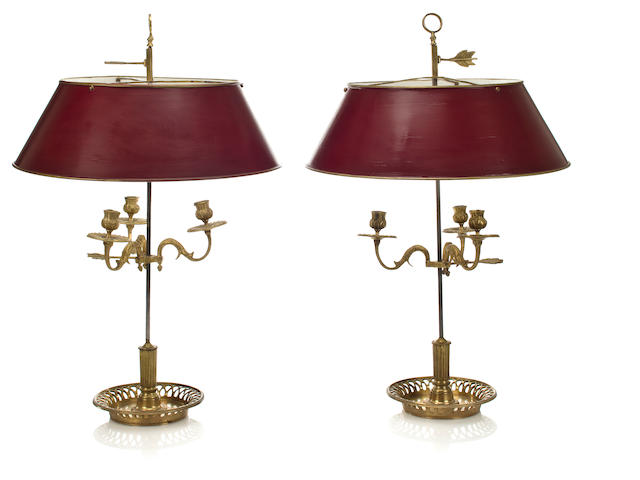 A pair of gilt bronze boulliotte lamps with red tole shades