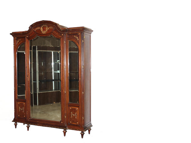 A Louis XVI style gilt bronze mounted and parquetry mirrored armoire and bed late 19th century