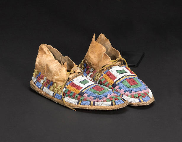 A pair of Arapaho beaded moccasins