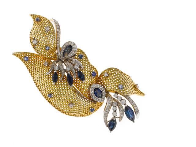 A sapphire and diamond ribbon motif brooch