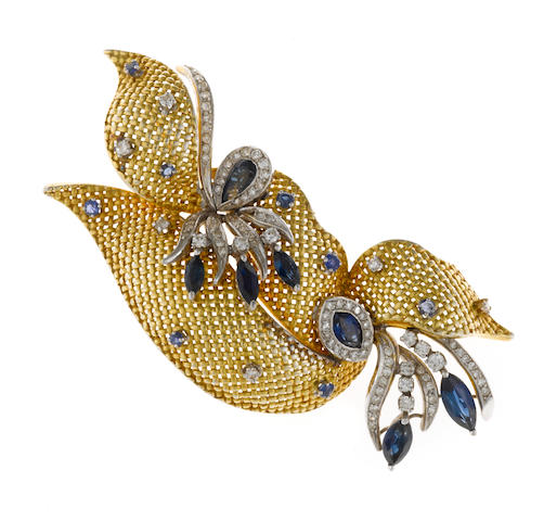 A sapphire and diamond ribbon motif brooch