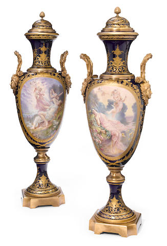 An imposing pair of Sèvres sytle earthenware gilt bronze mounted urns