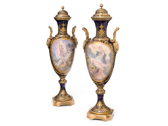 An imposing pair of Sèvres style earthenware gilt bronze mounted covered urns  20th century