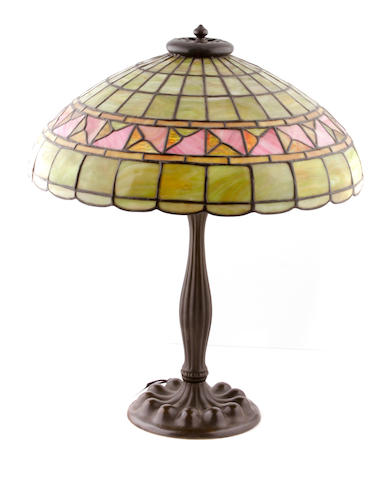 An American leaded glass and Duffner & Kimberly patinated metal lamp early 20th century