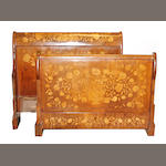 A Dutch Late Neoclassical floral marquetry and walnut sleigh bed