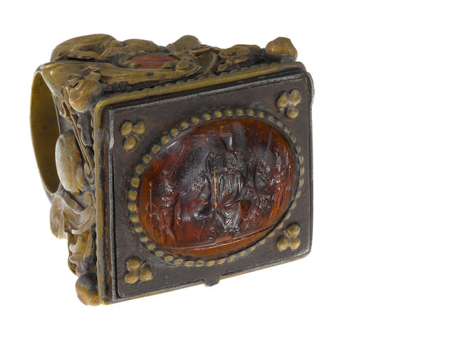 A carnelian intaglio and mixed metal bishop's ring