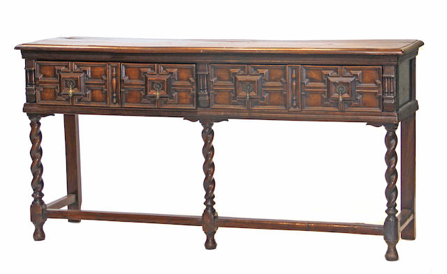 An English Jacobean style oak sideboard