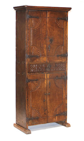A Spanish Baroque style oak cupboard