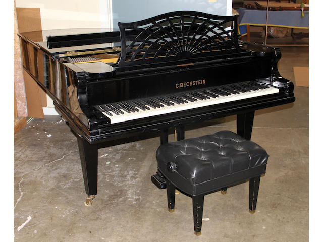 A C. Bechstein black lacquered grand piano model B with bench and later player