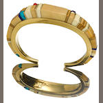 A Charles Loloma gold bracelet with inlay of bone, turquoise, coral and lapis