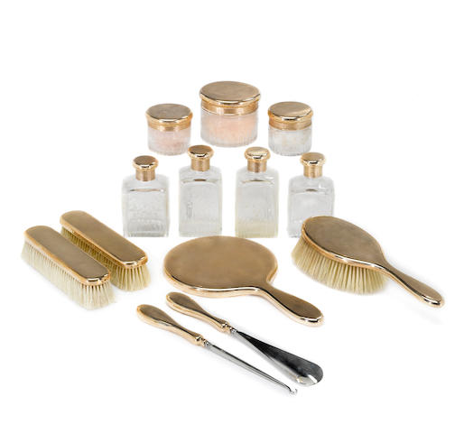 A nine karat gold thirteen piece vanity set with carrying case and outer cover, Asprey, London
