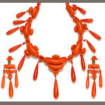 A carved coral necklace together with pendant earclips, retailed by Marsh & Co.