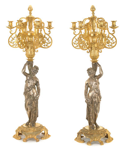 A pair of French silvered and gilt bronze figural six light candelabra  20th century