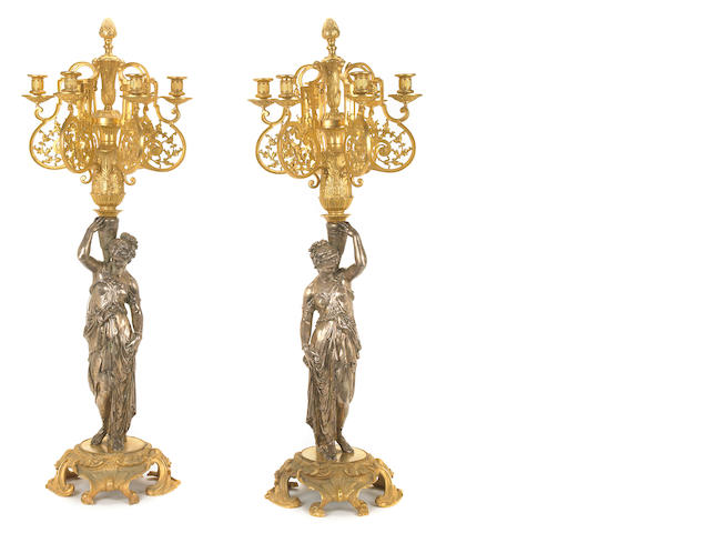 A pair of French silvered and gilt bronze figural six light candelabra