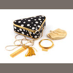 A black and white crystal polka dot triangular minaudiere,