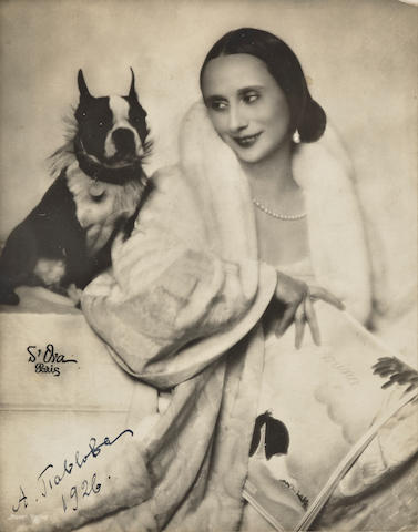 "PAVLOVA, ANNA. 1881-1931. Photograph Signed (""A. Pavlova"") in Cyrillic and dated 1926, platinum print, 8½ x 6½ inches, portrait of the ballerina with her Boston Terrier, Poppy,"