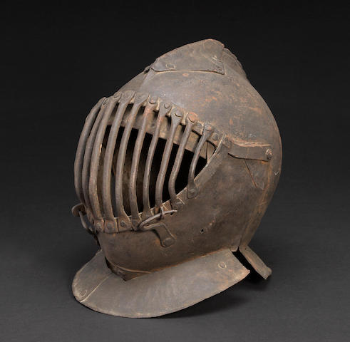 An Italian visored close helmet for the Pisan Gioco del Ponte