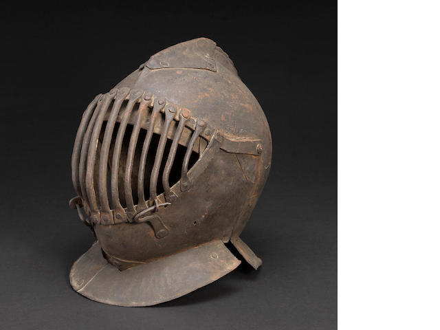 An Italian visored close helmet for the Pisan Gioco del Ponte