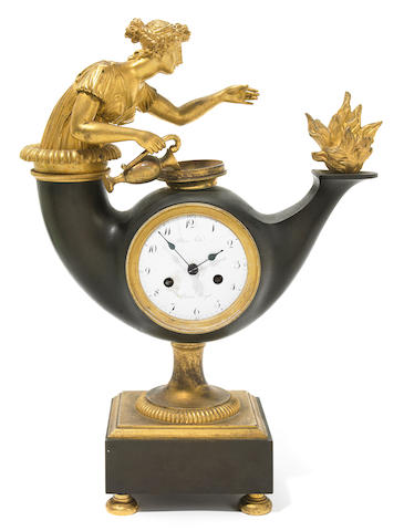An Empire gilt and patinated bronze mantel clock  early 19th century