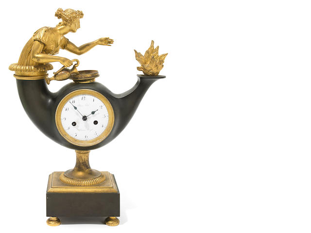 An Empire gilt and patinated bronze mantel clock