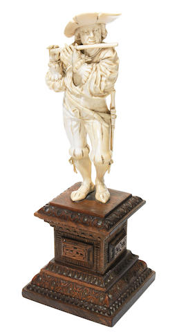 A German carved ivory figure of a musician
