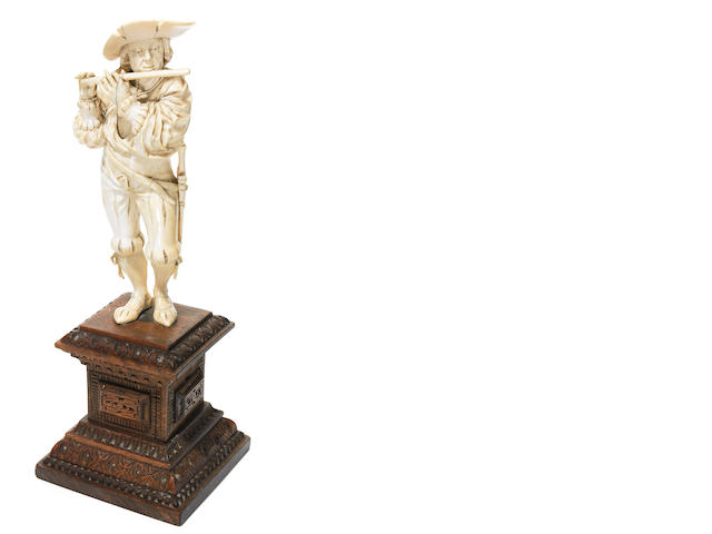 A German carved ivory figure of a musician- check sale